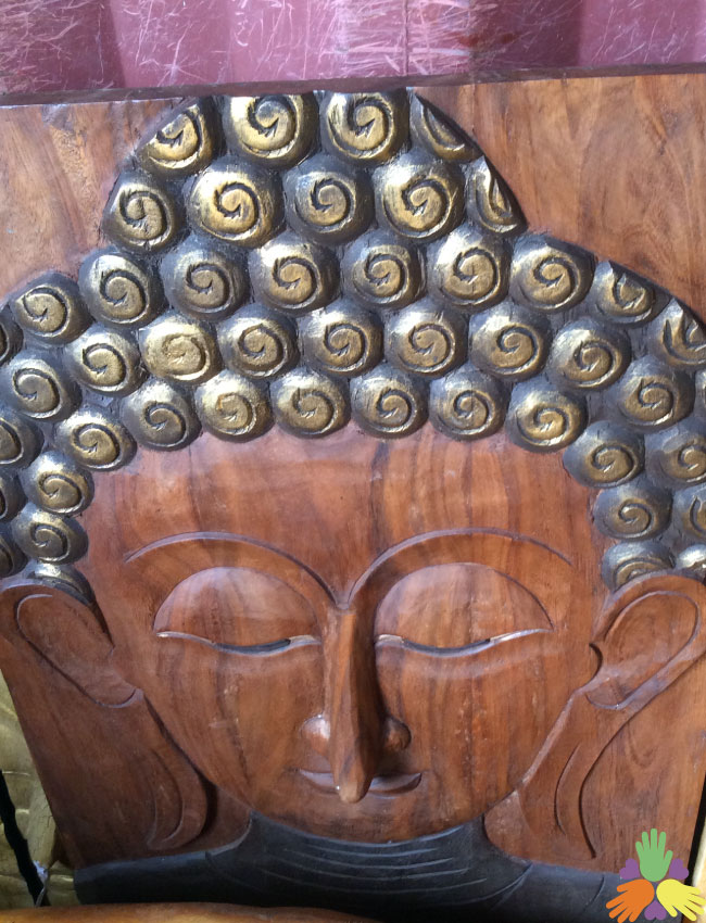 Buddha Face on Wood Plank